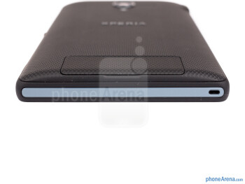 The microSD and SIM card slots are behind a flap on the back - Sony Xperia ZL Review