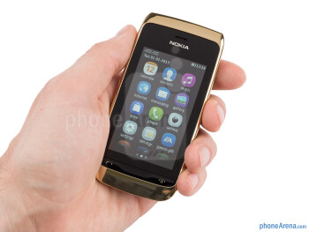 The Nokia Asha 310 is a soapy-shaped, comfortable to hold little handset - Nokia Asha 310 Review