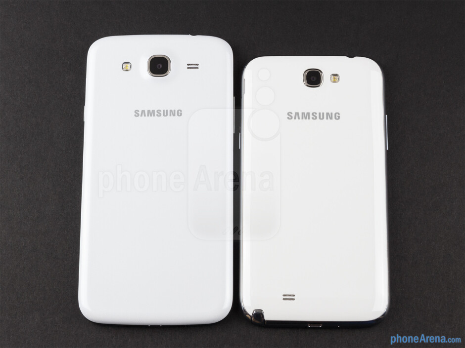 Backs - The sides of the Samsung Galaxy Mega 5.8 (bottom, left) and the Samsung Galaxy Note II (top, right) - Samsung Galaxy Mega 5.8 vs Samsung Galaxy Note II