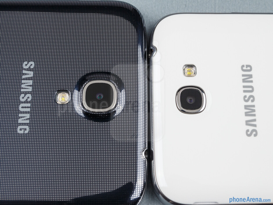 Rear cameras - The sides of the Samsung Galaxy Mega 6.3 (bottom, left) and the Galaxy Note II (top, right) - Samsung Galaxy Mega 6.3 vs Galaxy Note II