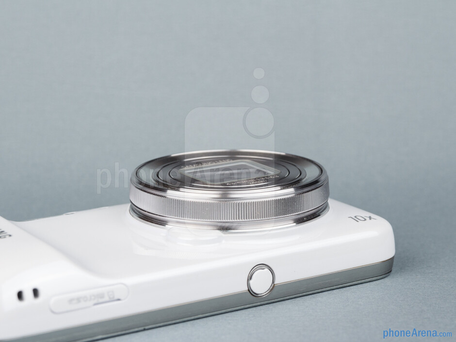 The Samsung Galaxy S4 Zoom is rather bulky, with a grip bulge and huge protruding lens with a zoom ring at the back - Samsung Galaxy S4 Zoom Preview