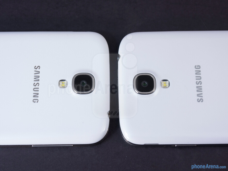 The sides of the Samsung Galaxy S4 Google Play Edition (left) and the Samsung Galaxy S4 (right) - Samsung Galaxy S4 Google Play Edition vs Samsung Galaxy S4