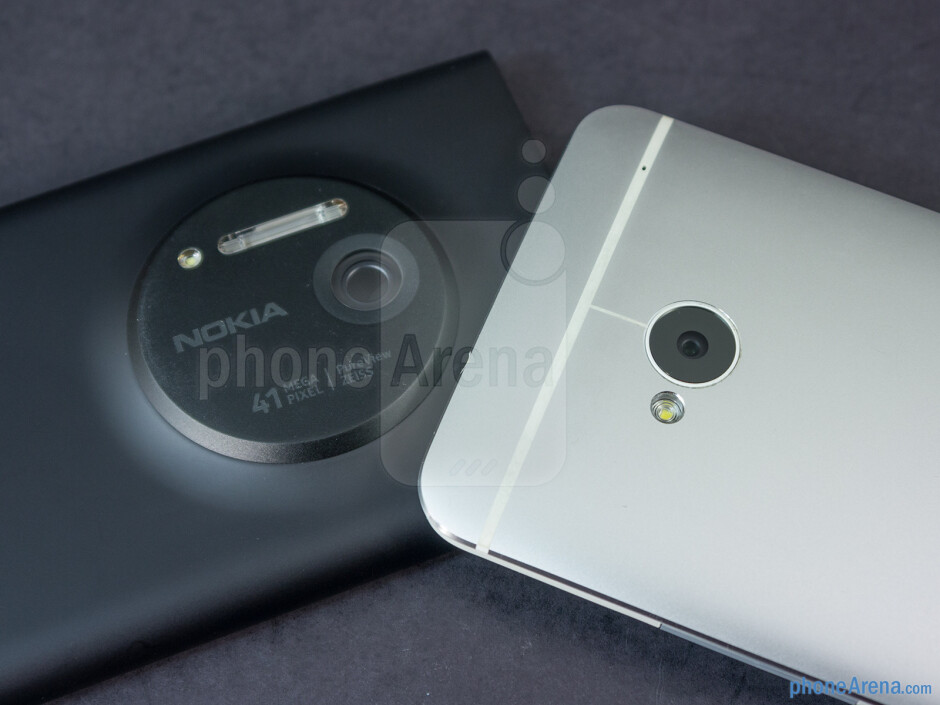 Rear cameras - The sides of the Nokia Lumia 1020 (left) and the HTC One (right) - Nokia Lumia 1020 vs HTC One