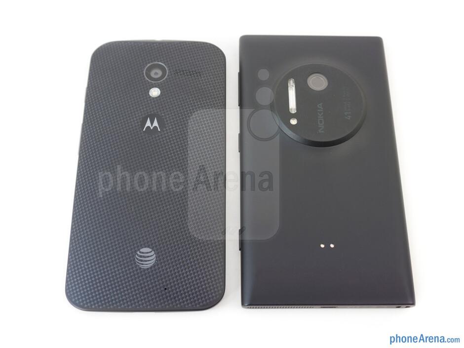 The sides of the Motorola Moto X (left, bottom) and the Nokia Lumia 1020 (right, top) - Motorola Moto X vs Nokia Lumia 1020