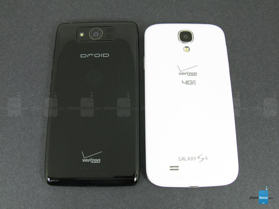 Backs - The sides of the Motorola DROID Ultra (bottom, left) and the Samsung Galaxy S4 (top, right) - Motorola DROID Ultra vs Samsung Galaxy S4