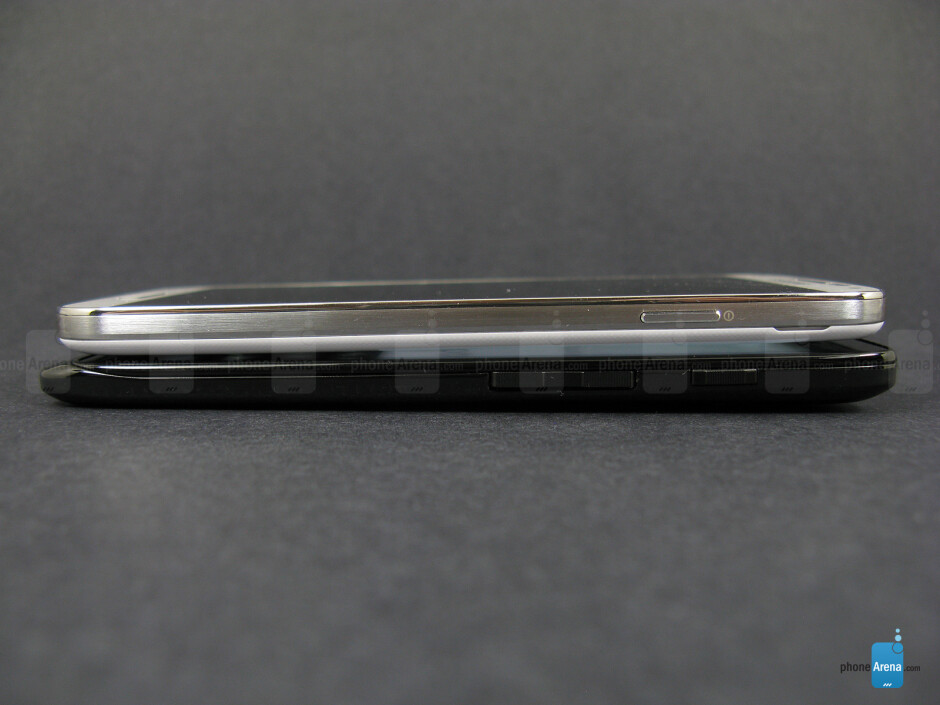 Right - The sides of the Motorola DROID Ultra (bottom, left) and the Samsung Galaxy S4 (top, right) - Motorola DROID Ultra vs Samsung Galaxy S4