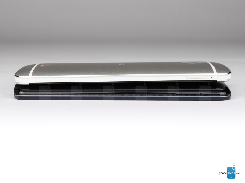 Left sides - The sides of the LG G2 (bottom, left) and the HTC One (top, right) - LG G2 vs HTC One