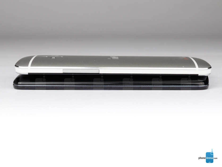 Right - The sides of the LG G2 (bottom, left) and the HTC One (top, right) - LG G2 vs HTC One