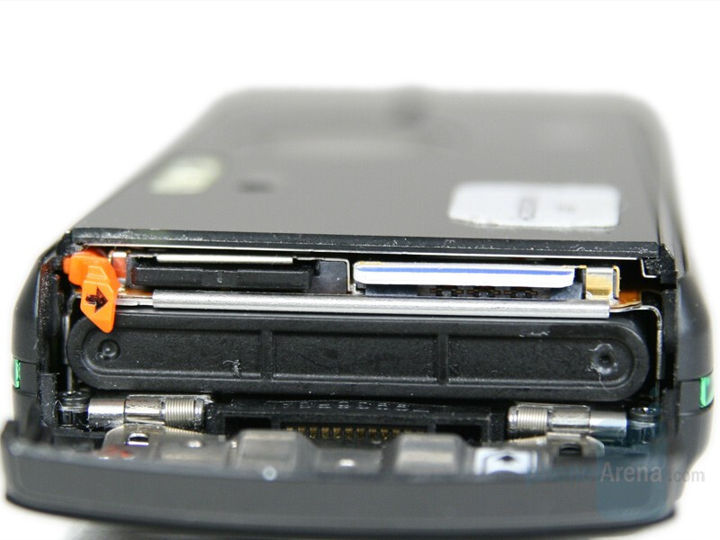 Memory card slot, SIM card slot and Battery below - Sony Ericsson K850 Preview