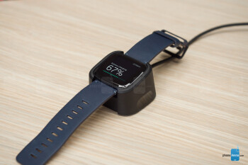 To charge the Versa, you place it on a clip-like dock - Fitbit Versa smartwatch Review