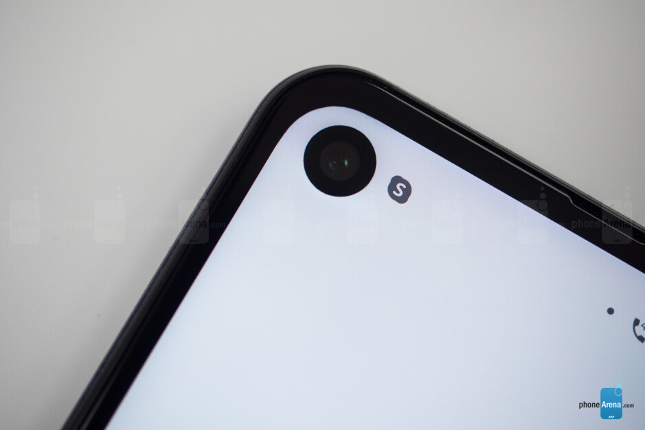 The LCD backlight can be seen at the bottom, the selfie camera cutout throws a small shadow towards the corner of the phone - Motorola One Action Review: a phone with an action camera