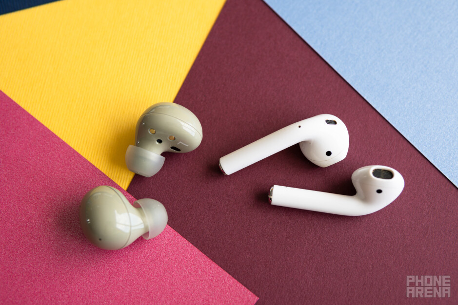 The Samsung Galaxy Buds 2 earbuds next to Apple's AirPods - Samsung Galaxy Buds 2 review – the right sound for the right price