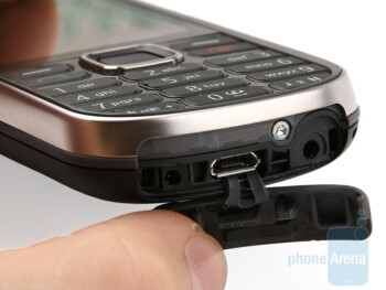 The microUSB port and 2.5mm jack are protected,but the charger port is exposed all the time - Nokia 3720 classic Review