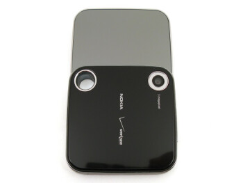 Located on the sides are the volume rocker, microUSB port, 2.5mm headset jack, microSDHC memory card slot and external speaker - Nokia 7705 Twist Review