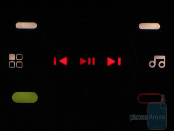 When the music player is activated the d-pad morphs to include track forward/back and play/pause functions - Motorola Debut i856 Review