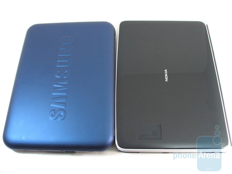 Next to Nokia Booklet 3G - Samsung Go N310 won't win any awards for turning heads with its uniform bluish colored soft touch feeling material covering it. - Samsung Go N310 Review