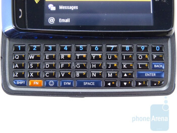Sliding the LG Rumor Touch open reveals its spacious 5 row QWERTY keyboard - LG Rumor Touch Review