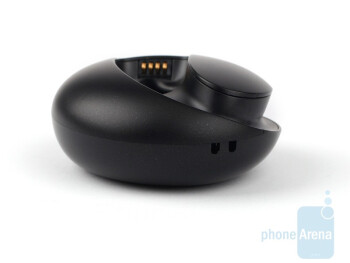 The charger stand of the Jabra STONE has a microUSB port,and a small LED light next to it that indicates the remaining charge - Jabra STONE Review