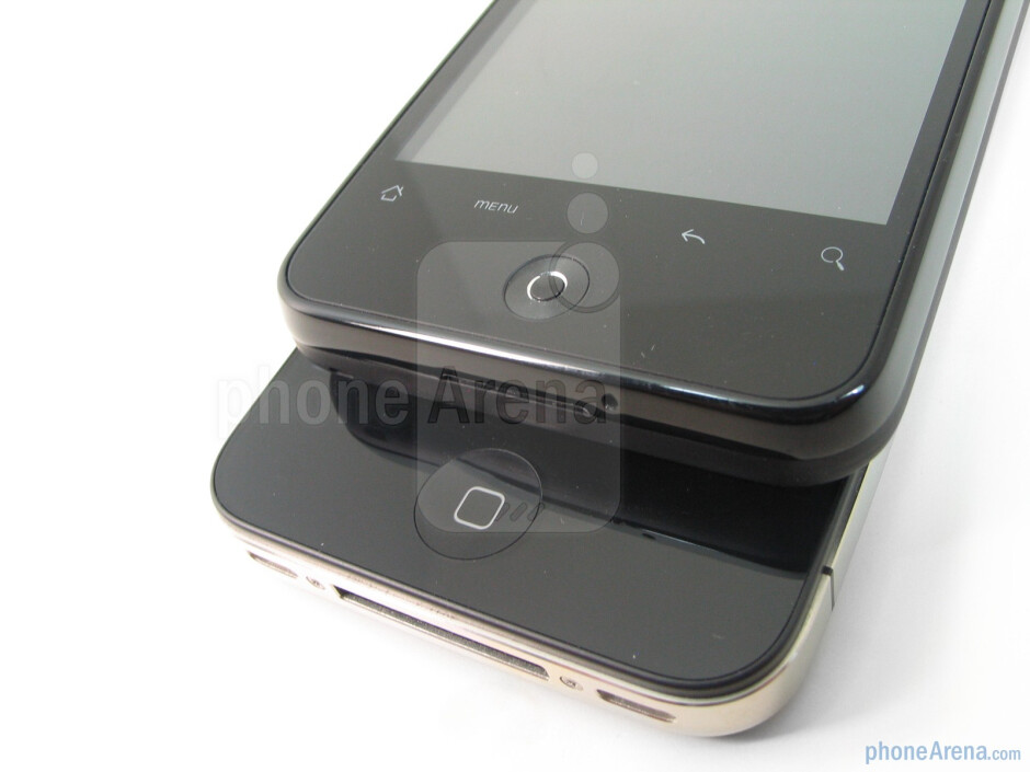 The buttons of the Apple iPhone 4 (down)and the HTC Droid Incredible (up) - The rear covers of both devices do wellin repelling scratches and dirt - Apple iPhone 4 vs. HTC Droid Incredible