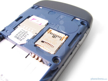 Removing the back cover will get you access to the battery, SIM card slot, and microSD card slot - LG Sentio Review