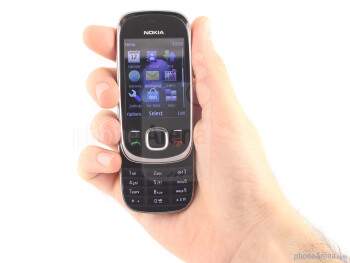 The Nokia 7230 is a slim slider with a glossy, curvaceous design - Nokia 7230 Review