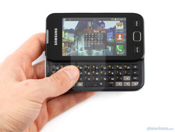 The Samsung Wave 533 is a plain looking all-plastic handset with a chrome-like rim around it - Samsung Wave 533 Review