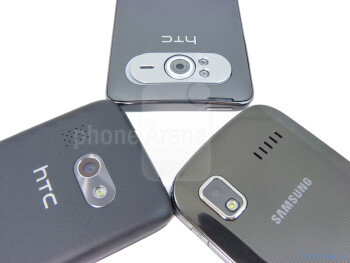 From left to right - HTC Surround, HTC HD7, Samsung Focus - All three smartphones pack 5-megapixel cameras - HTC HD7 vs HTC Surround vs Samsung Focus