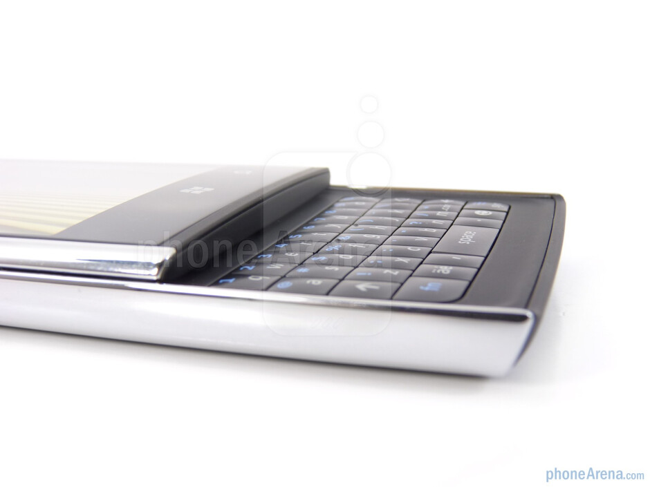 Sliding the phone open reveals its 4-row portrait style QWERTY keyboard - Dell Venue Pro Review