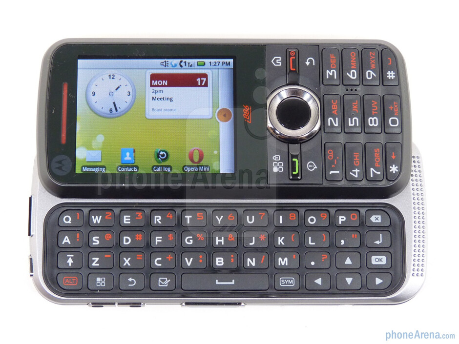 The Motorola i886 uses a spring assisted slide mechanism to snap out the full QWERTY keyboard - Motorola i886 Review