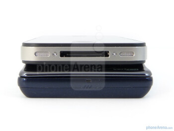 The sides of the Motorola DROID 2 Global (left, bottom) and the Apple iPhone 4 (right, top) - Verizon iPhone 4 vs DROID 2 Global
