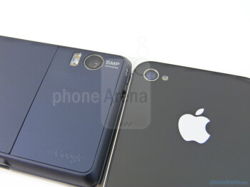 The backs of the Motorola DROID 2 Global (L) and the Apple iPhone 4 (R) - Verizon iPhone 4 vs DROID 2 Global