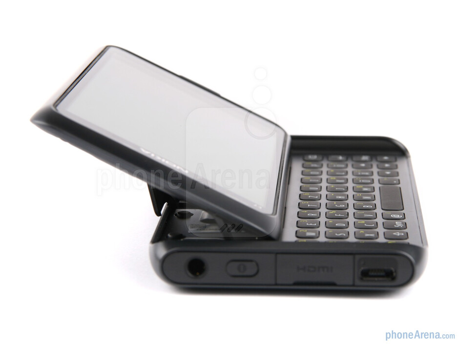 The two hinges are designed to lift and tilt the screen half in a somewhat diagonal manner - Nokia E7 Review