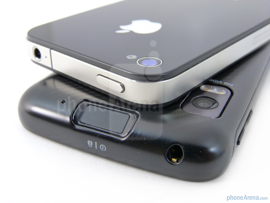 Power buttons on top - The sides of the Motorola ATRIX 4G (bottom) and the Apple iPhone 4 (top) - Motorola ATRIX 4G vs Apple iPhone 4