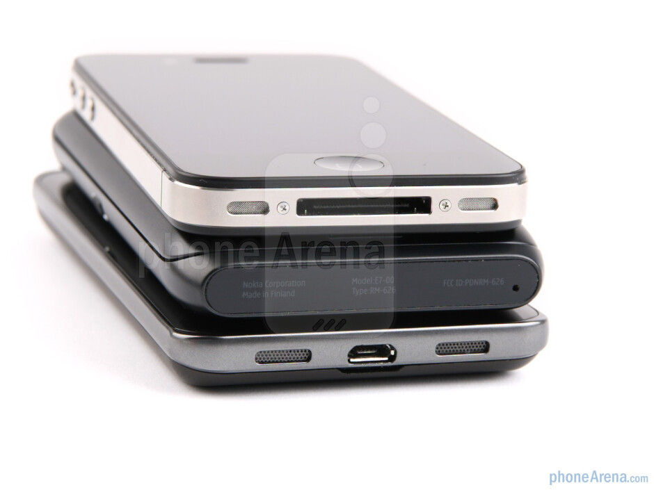 Bottom - The sides of the Apple iPhone 4 (top), the Nokia E7 (middle) and the LG Optimus 2X (bottom) - Nokia E7 vs LG Optimus 2X vs Apple iPhone 4