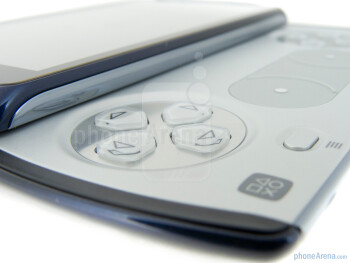 Sliding up the handset to reveal its PlayStation fashioned gaming pad - Sony Ericsson Xperia PLAY 4G Review